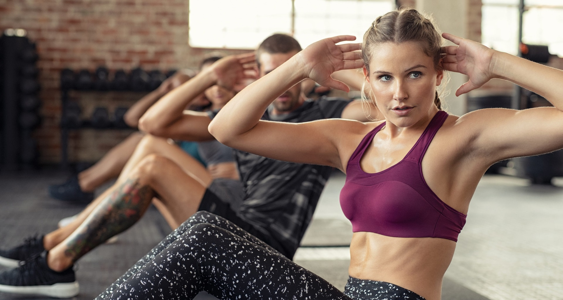Woman doing abs exercise at cardio course