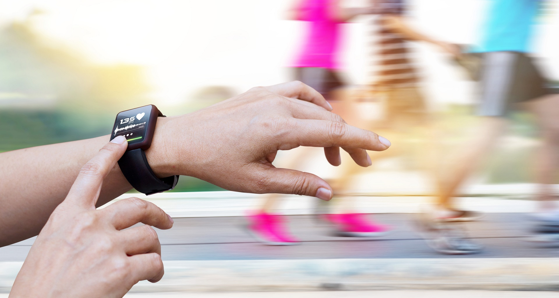 Woman checking up heart rate from smart watch