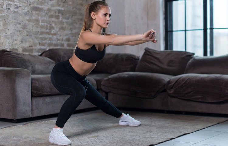 home workout performing lateral lunges